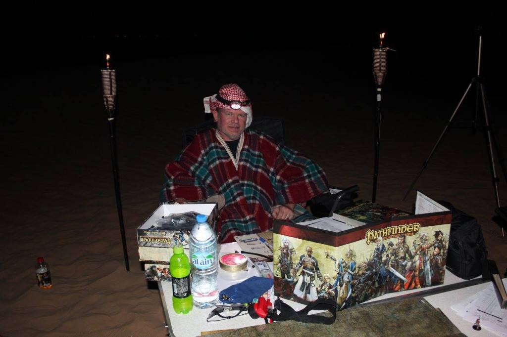 Andy Staples running Citadel of Flame. Note the head light and the camel blanket worn as a poncho. Photo by Jerome Devie.